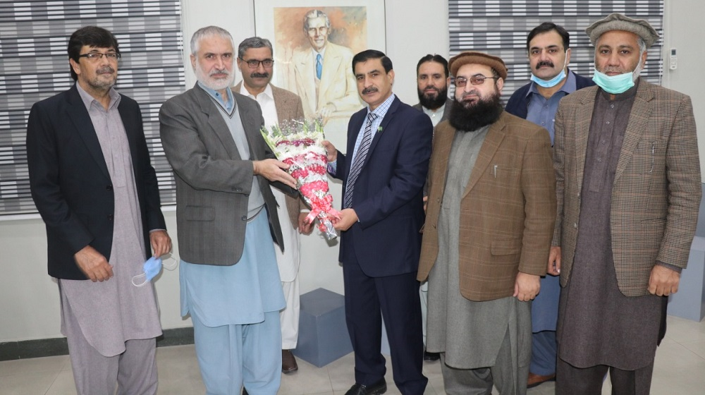 Pro-VC Prof. Dr. Muhammad Abid presenting bouquet to the newly appointed Vice Chancellor Prof. Dr. Muhammad Idrees at the Vice Chancellor's Office, University of Peshawar.