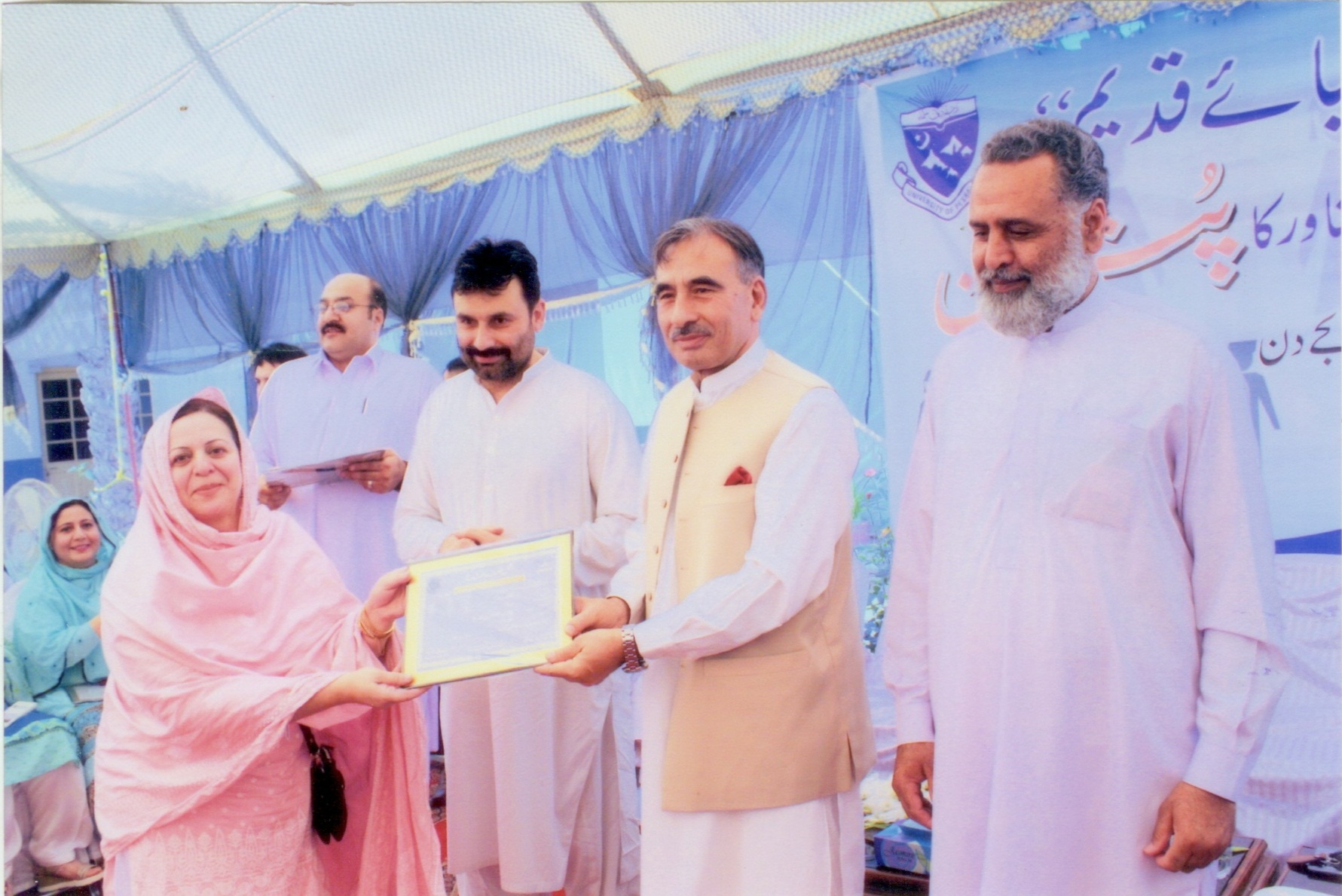 Dr. Rubina Shaheen Receiving Certificate from the Vice Chancellor