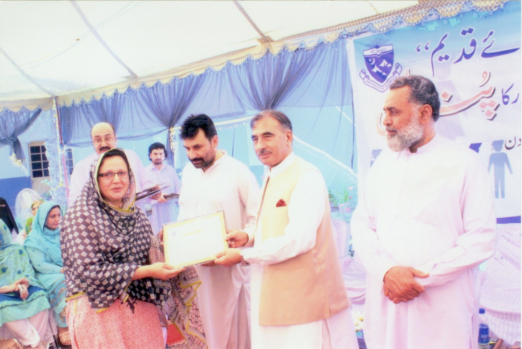 Vice Chancellor Presenting Certificate to the Faculty