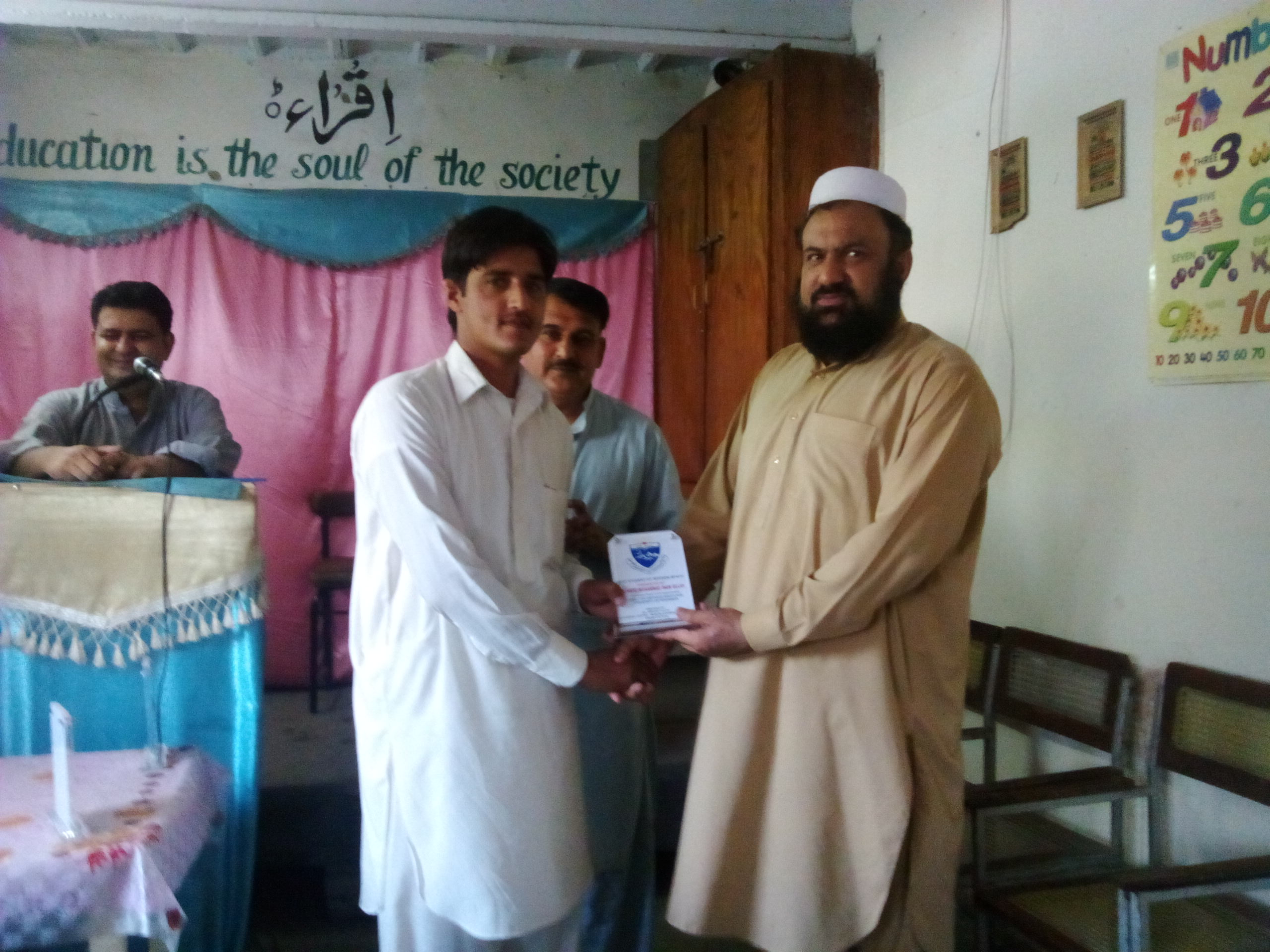 Dr. Hafiz Muhammad Inamullah distributing awards to best student of the year.