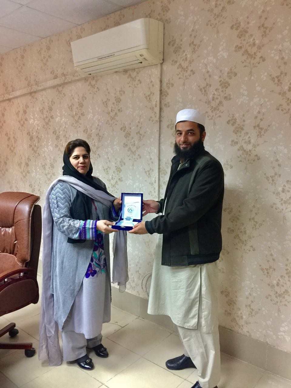 VC WUM presenting shield to Mr. Salman Jan, Assistant Registrar (QE)
