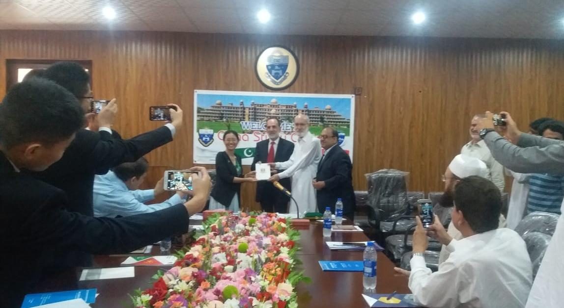 Dr Zahid Anwar giving shield to DG China Embassy Islamabad